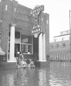 1951 era, photo of front of Kansas State Bank in flood with men fishing off front steps